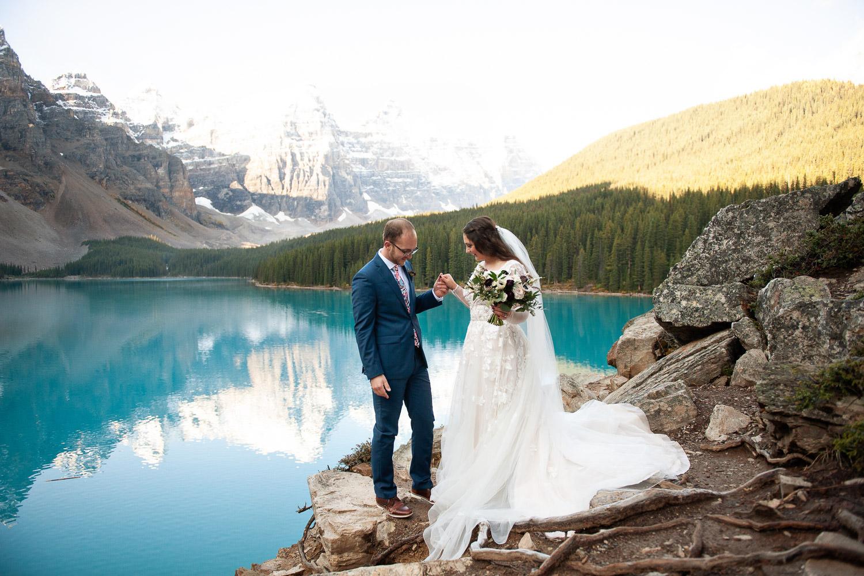 Newlyweds on the Rockpile at Moraine Lake captured by Tara Whittaker Photography