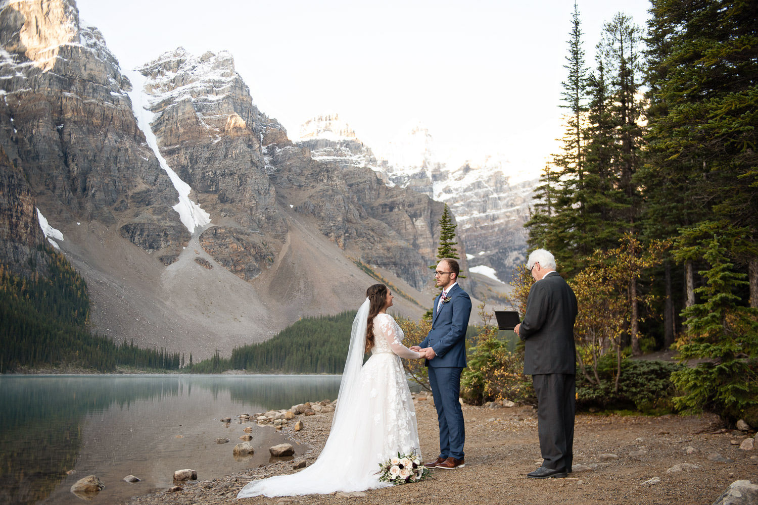 Wedding ceremony on the shore of Moraine Lake captured by Tara Whittaker Photography