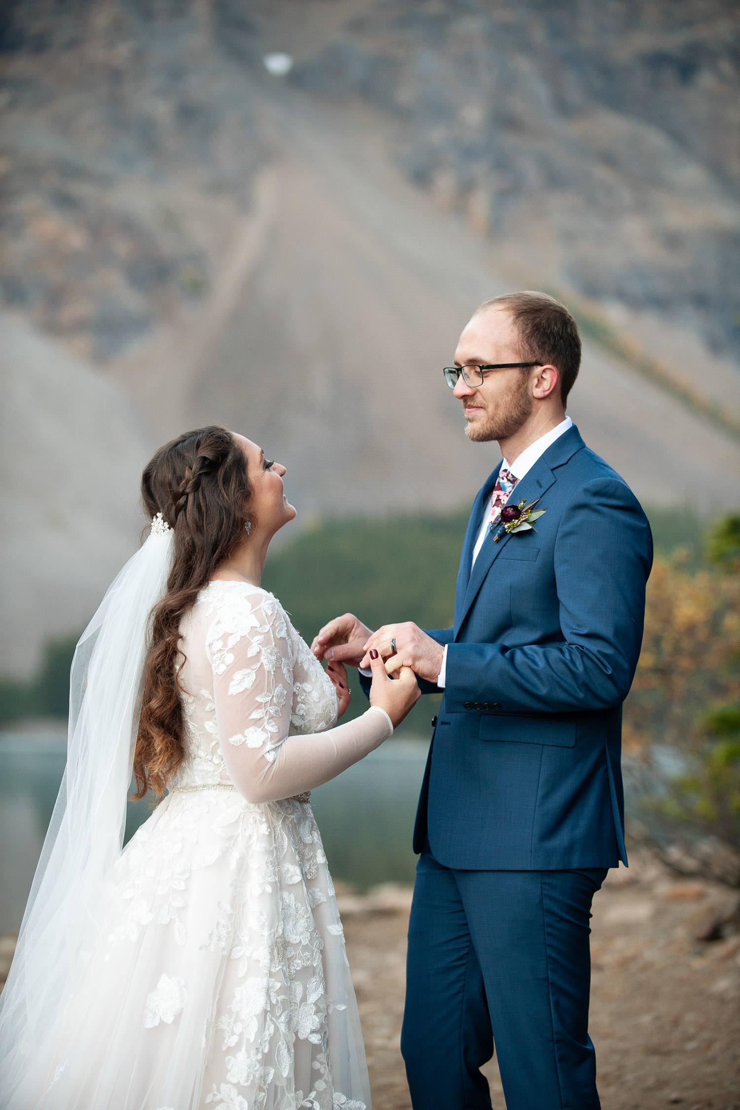 Just married at Moraine Lake capture by Calgary wedding photographer Tara Whittaker