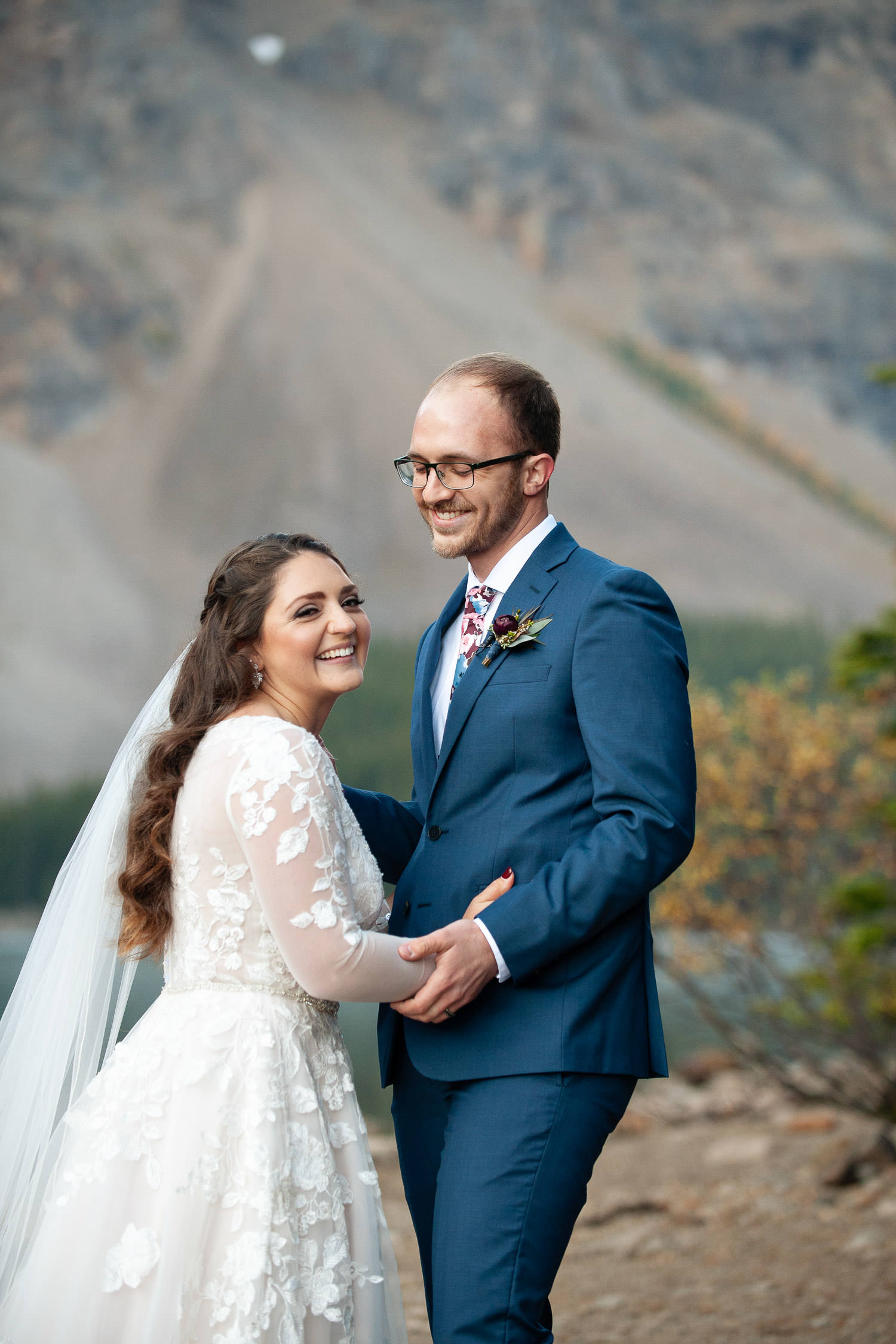 Happy bride and groom at their Moraine Lake elopement captured by Tara Whittaker Photography
