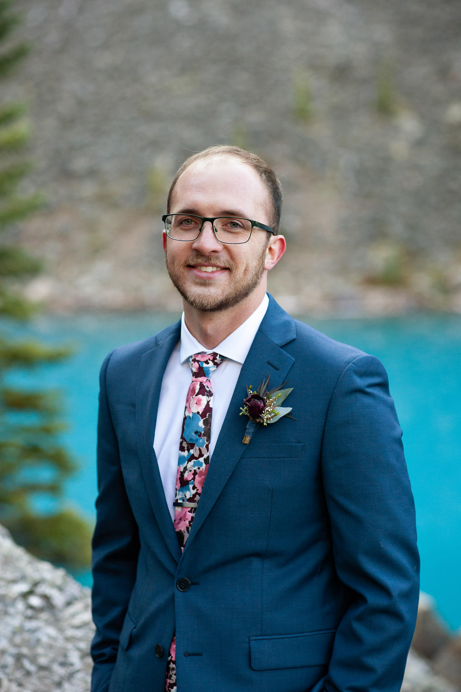 Groom at Moraine Lake captured by Tara Whittaker Photography