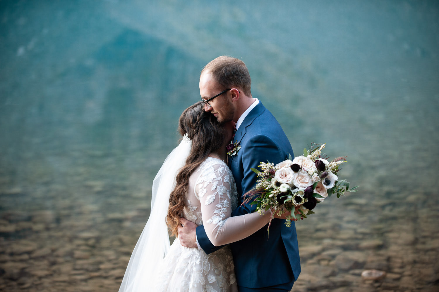 Bride and groom at their Moraine Lake elopement captured by Tara Whittaker Photography