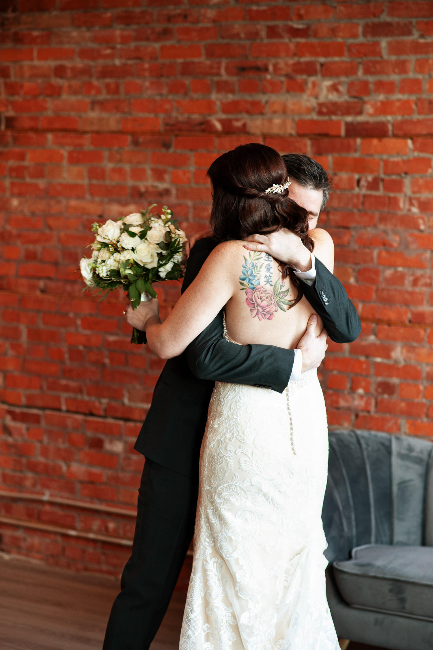 Couple embrace during their first look at Venue 308 captured by Tara Whittaker Photography
