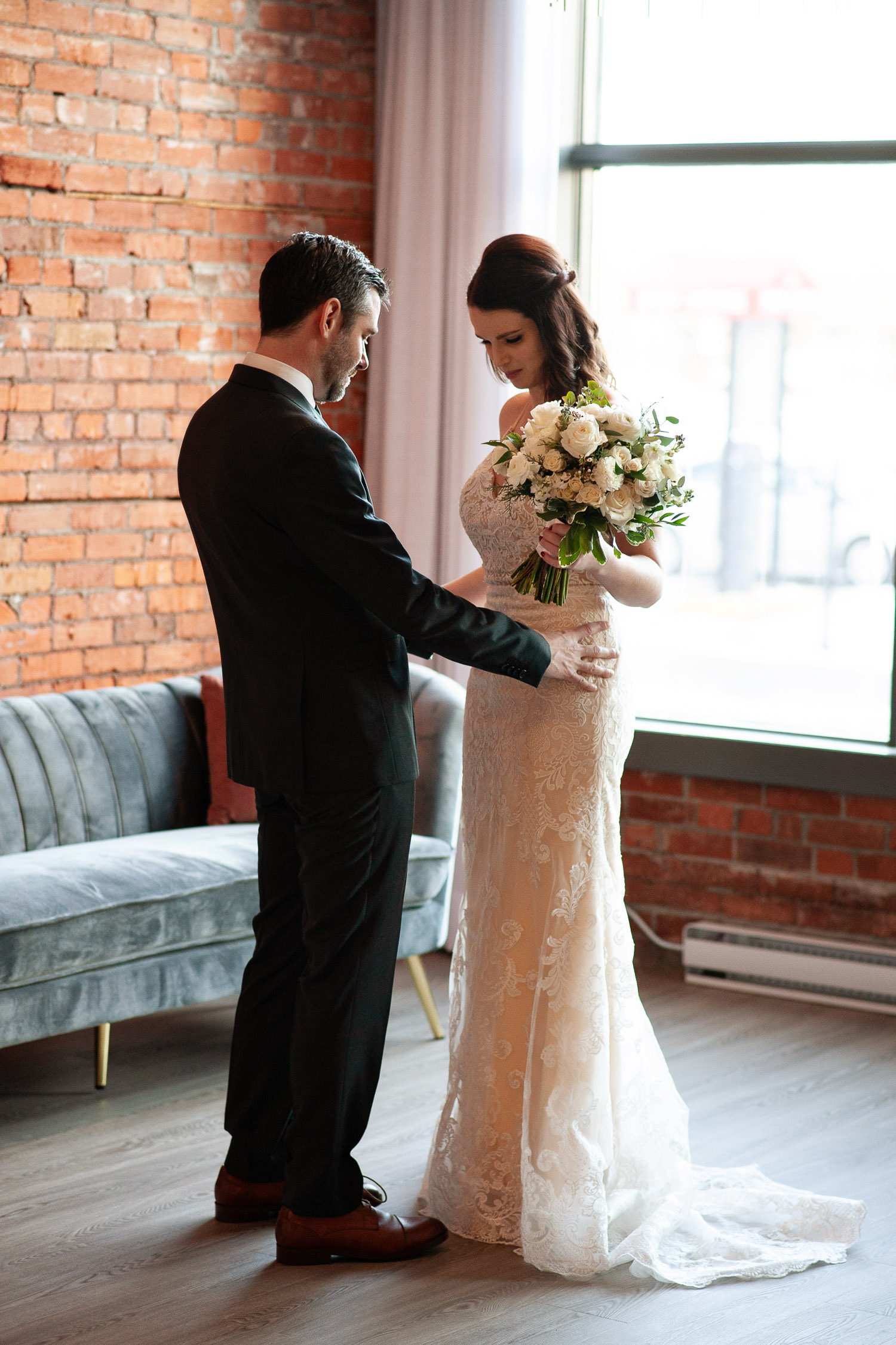 Bride and groom during their first look at Venue 308 captured by Calgary wedding photographer Tara Whittaker
