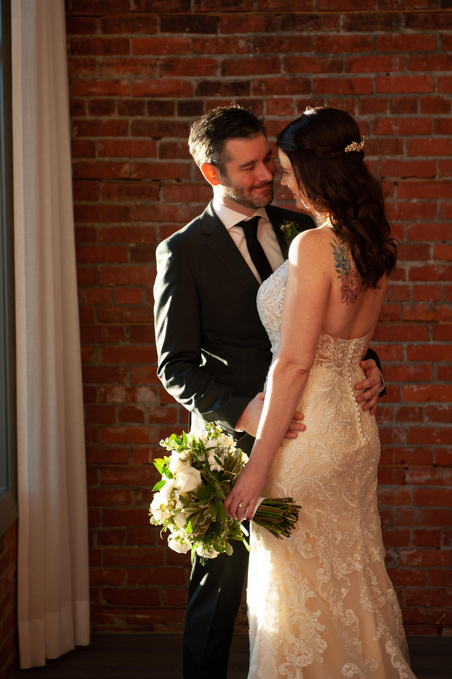 bride and groom cozy up at Venue 308 in Calgary captured by Tara Whittaker Photography