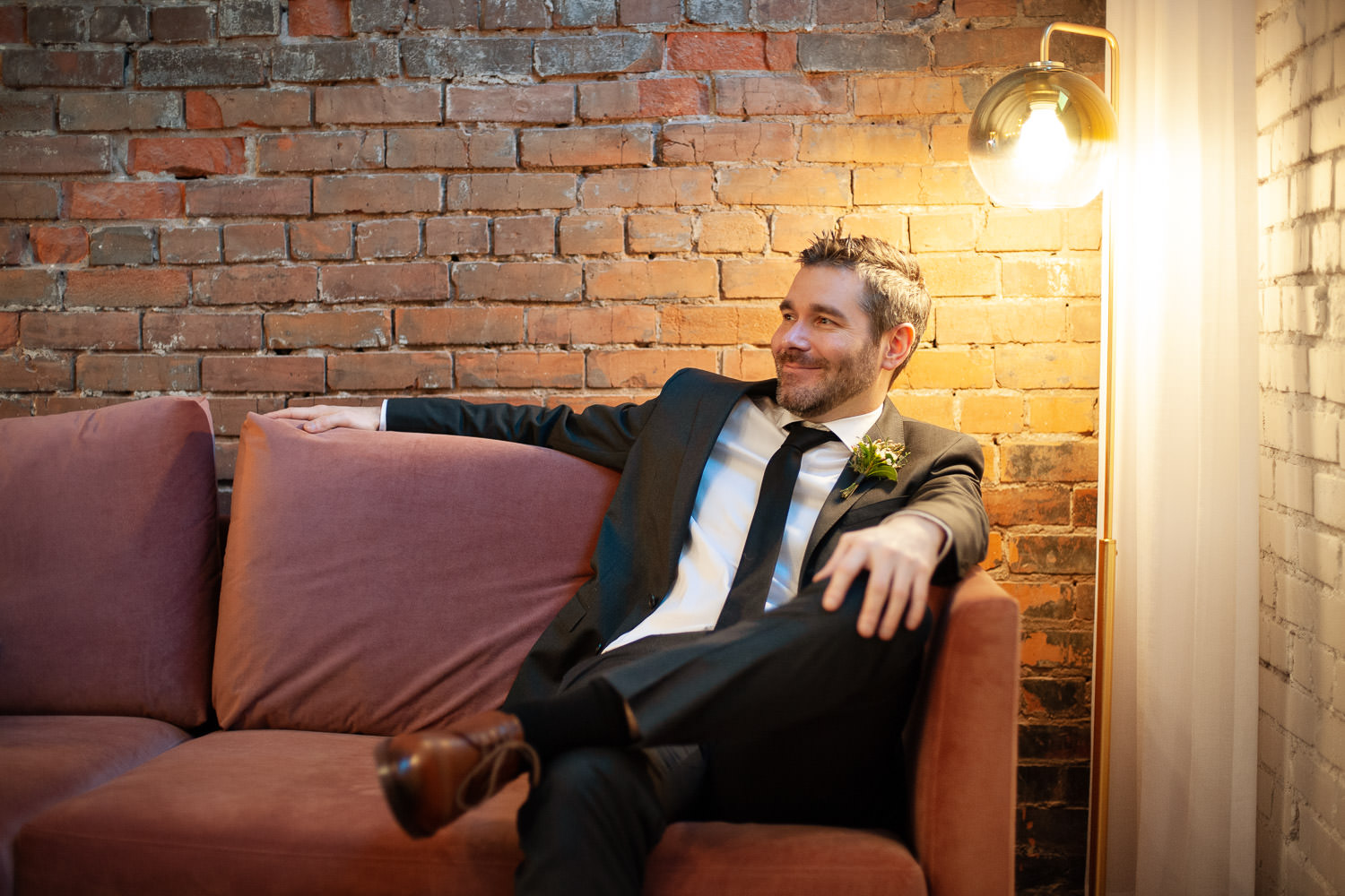 Groom inside the Grace Lounge at Venue 308 captured by Tara Whittaker Photography