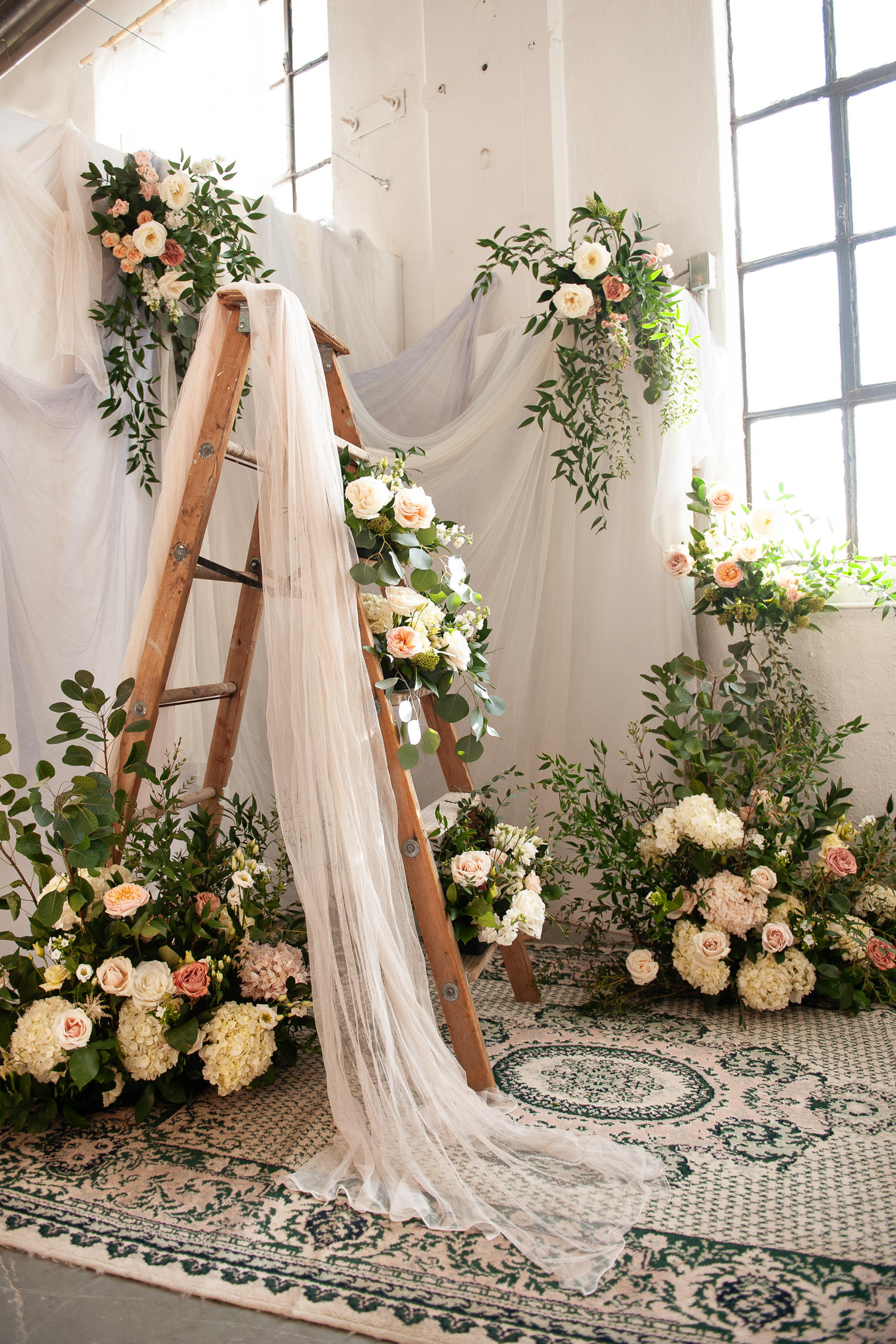 Vintage ladder adorned with flowers captured by Tara Whittaker Photography