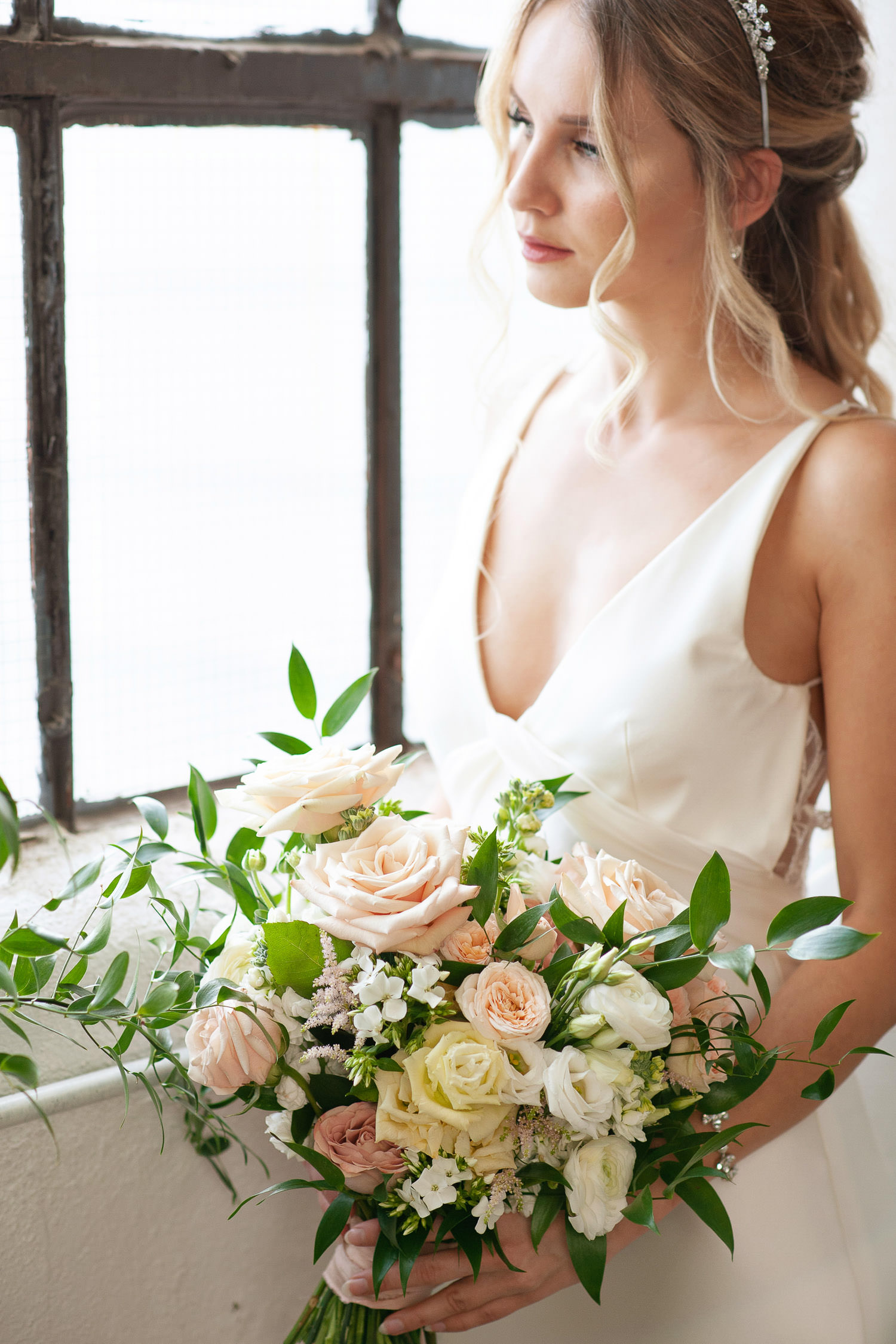 bridal bouquet in peach and white captured by Tara Whittaker Photography