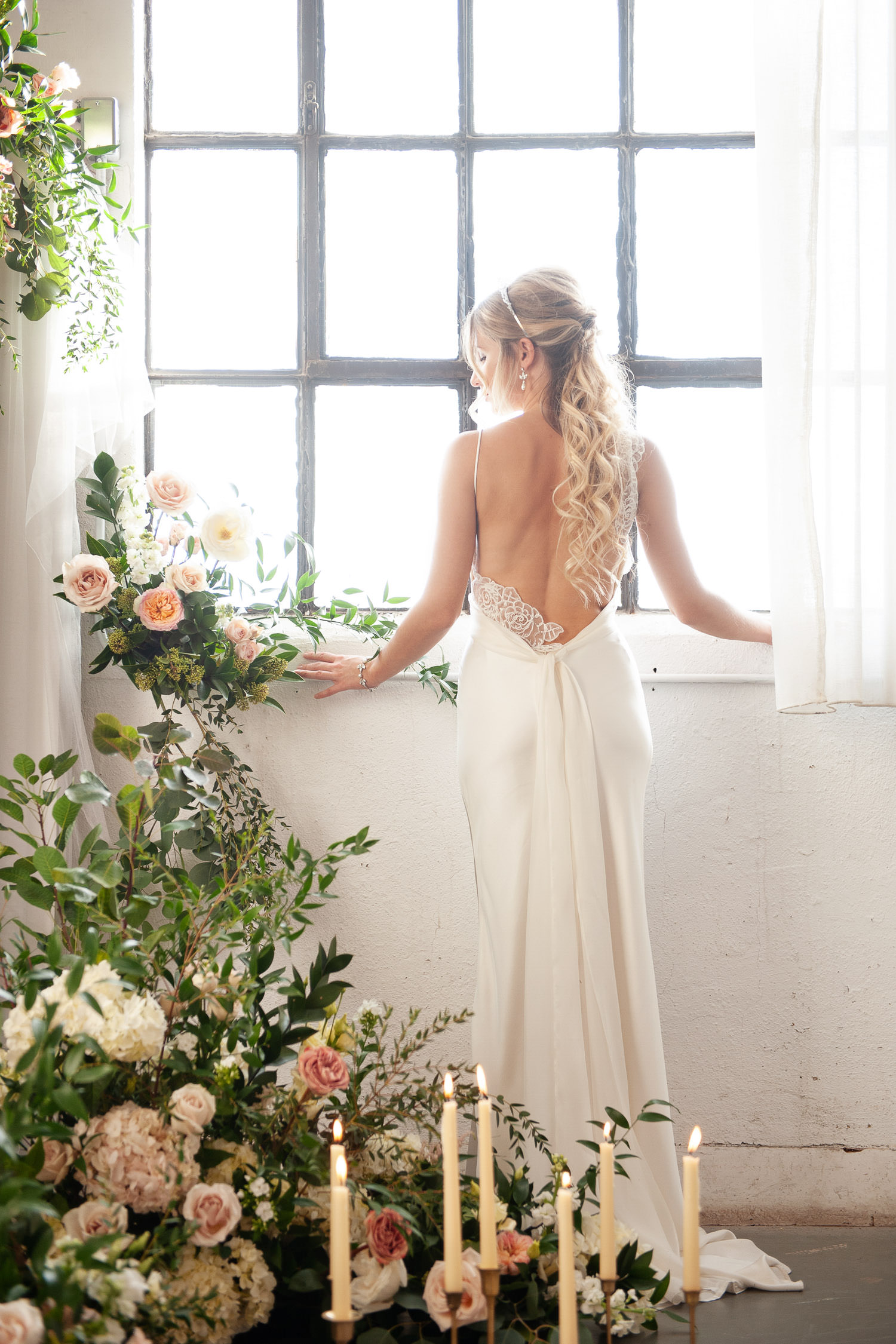 bride with flowers and candles captured by Tara Whittaker Photography