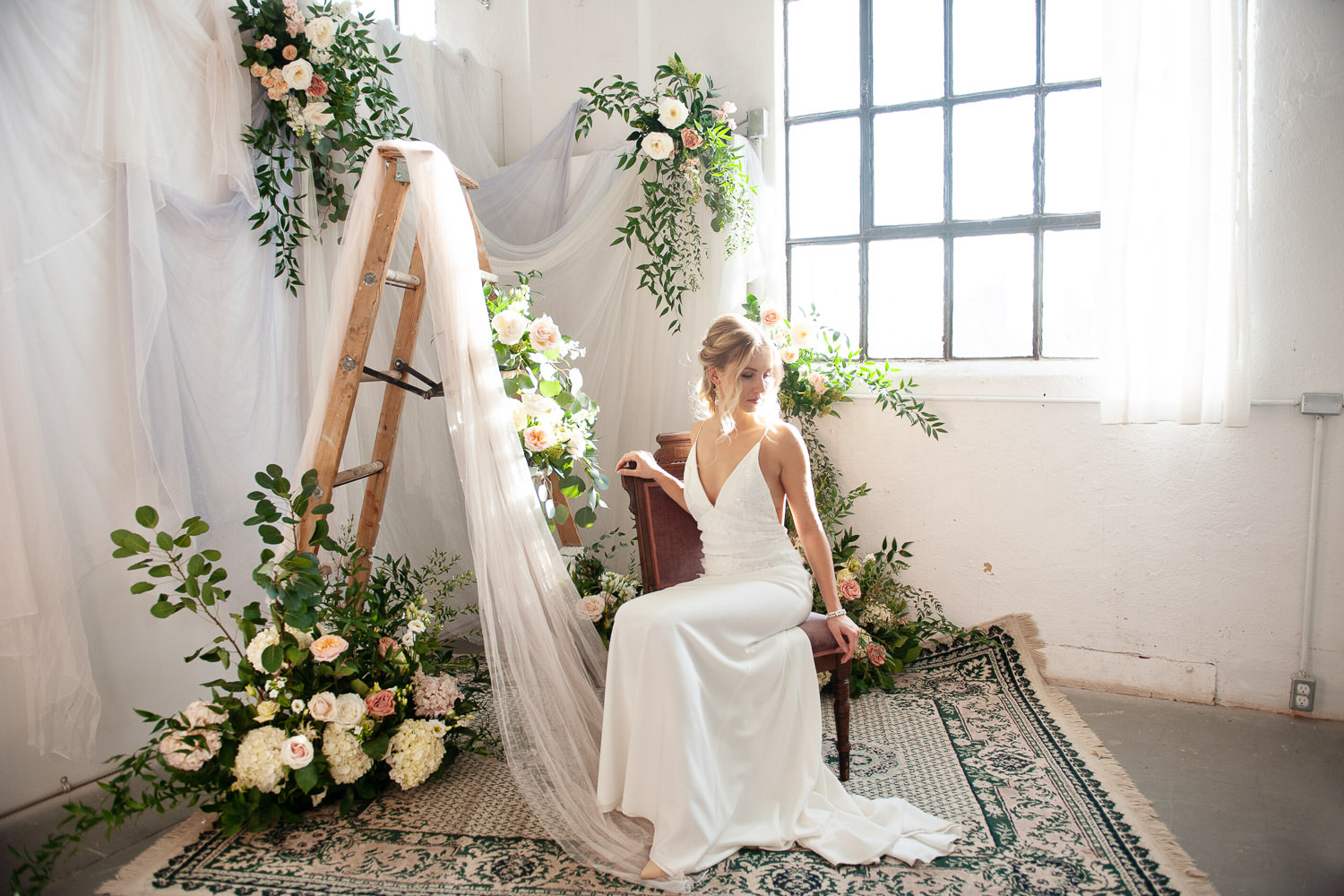 bride seated at Workshop Studios captured by Tara Whittaker Photography