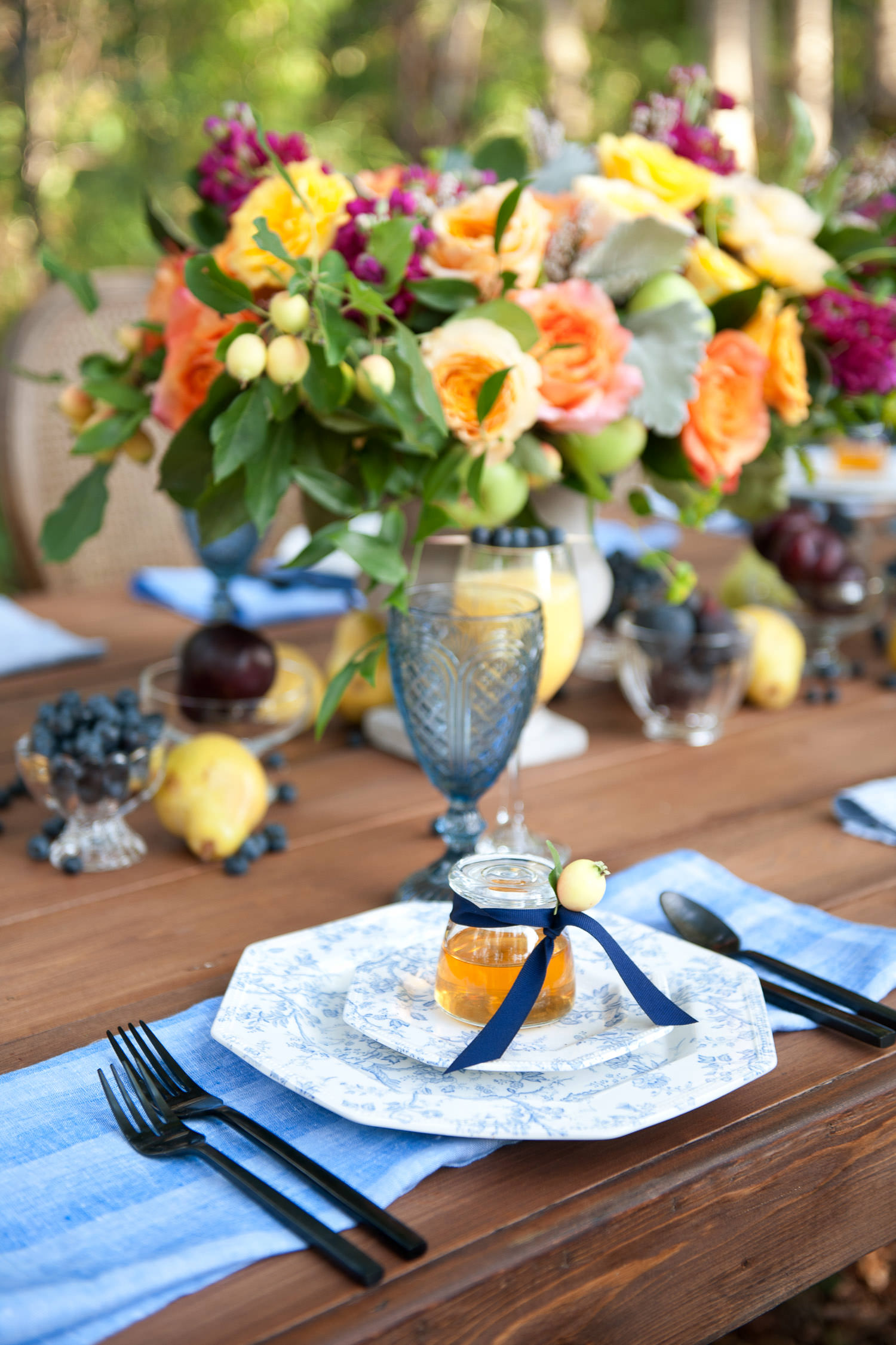 jars of honey at a place setting for a brunch wedding captured by Tara Whittaker Photography