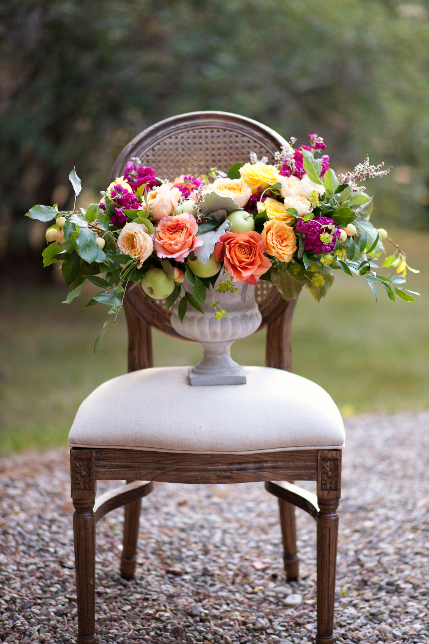 floral centerpiece sitting on a chair captured by Tara Whittaker Photography