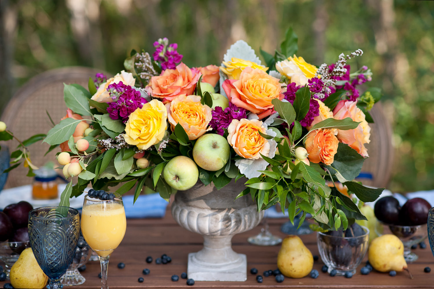 fruit and florals for table decor at a summer wedding captured by Tara Whittaker Photography