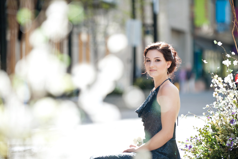 Calgary graduate on Stephen Avenue captured by Tara Whittaker Photography