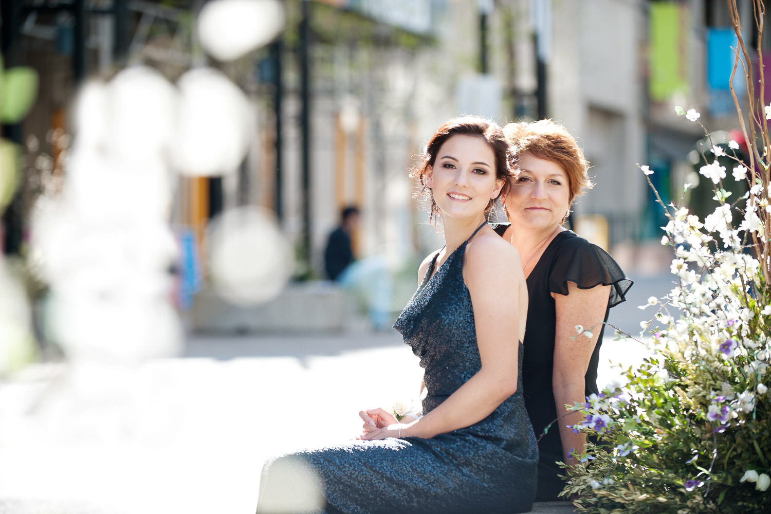 grad and her mom pose for photos on Stephen Avenue captured by Tara Whittaker Photography