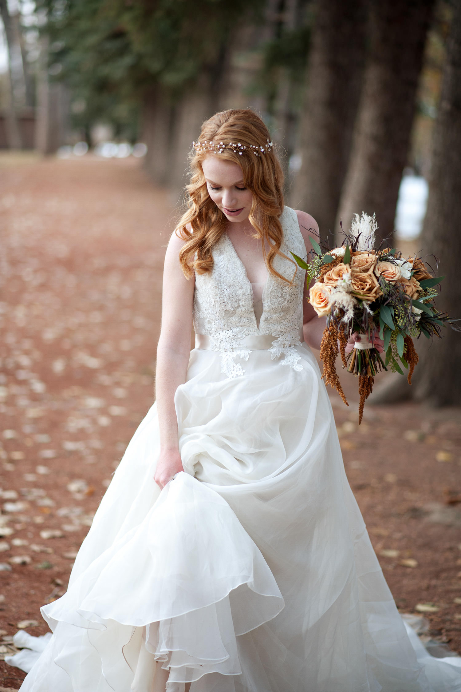 Fall bride walking in the leaves captured by Tara Whittaker Photography