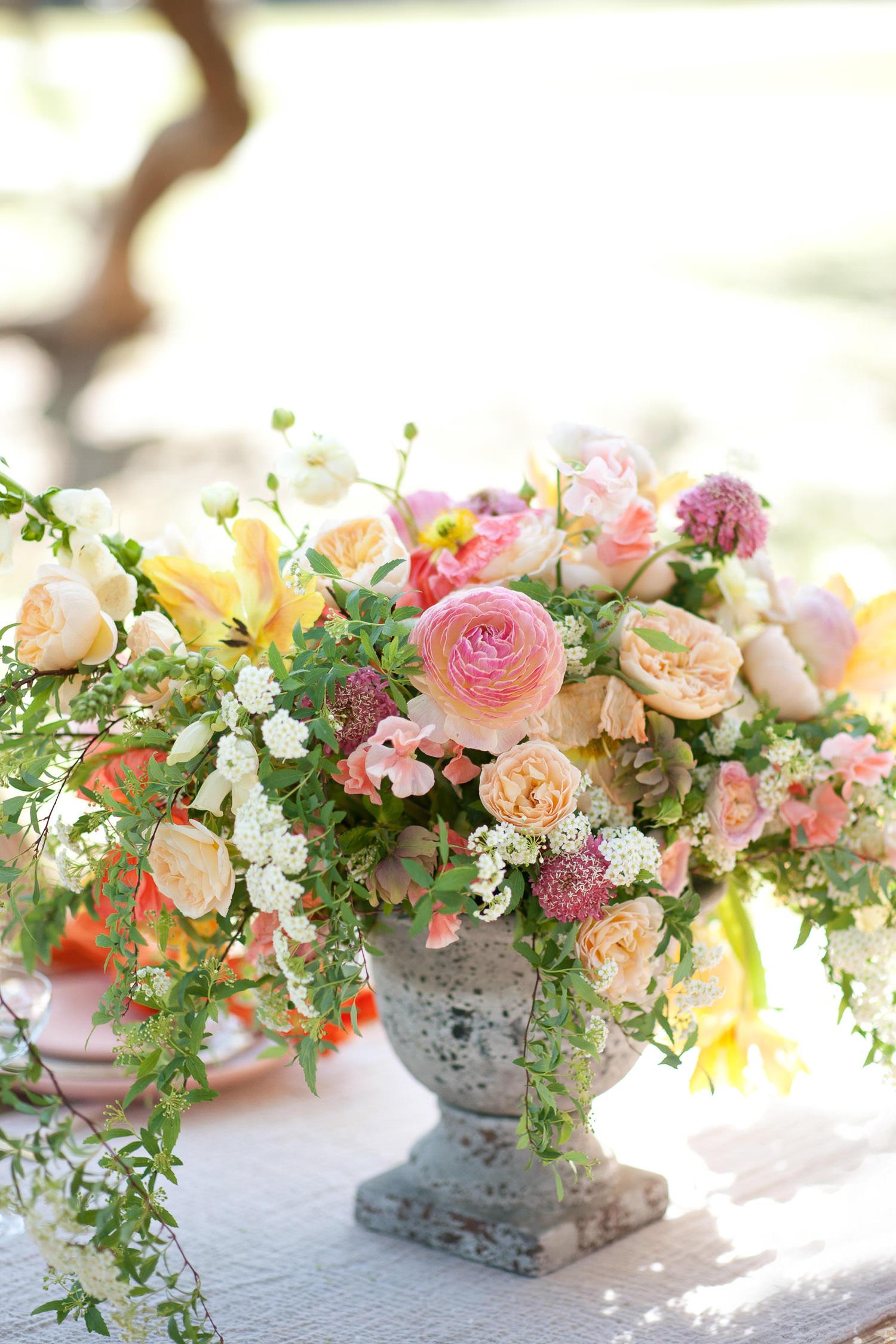 Spring centerpiece at a garden wedding captured by Tara Whittaker Photography