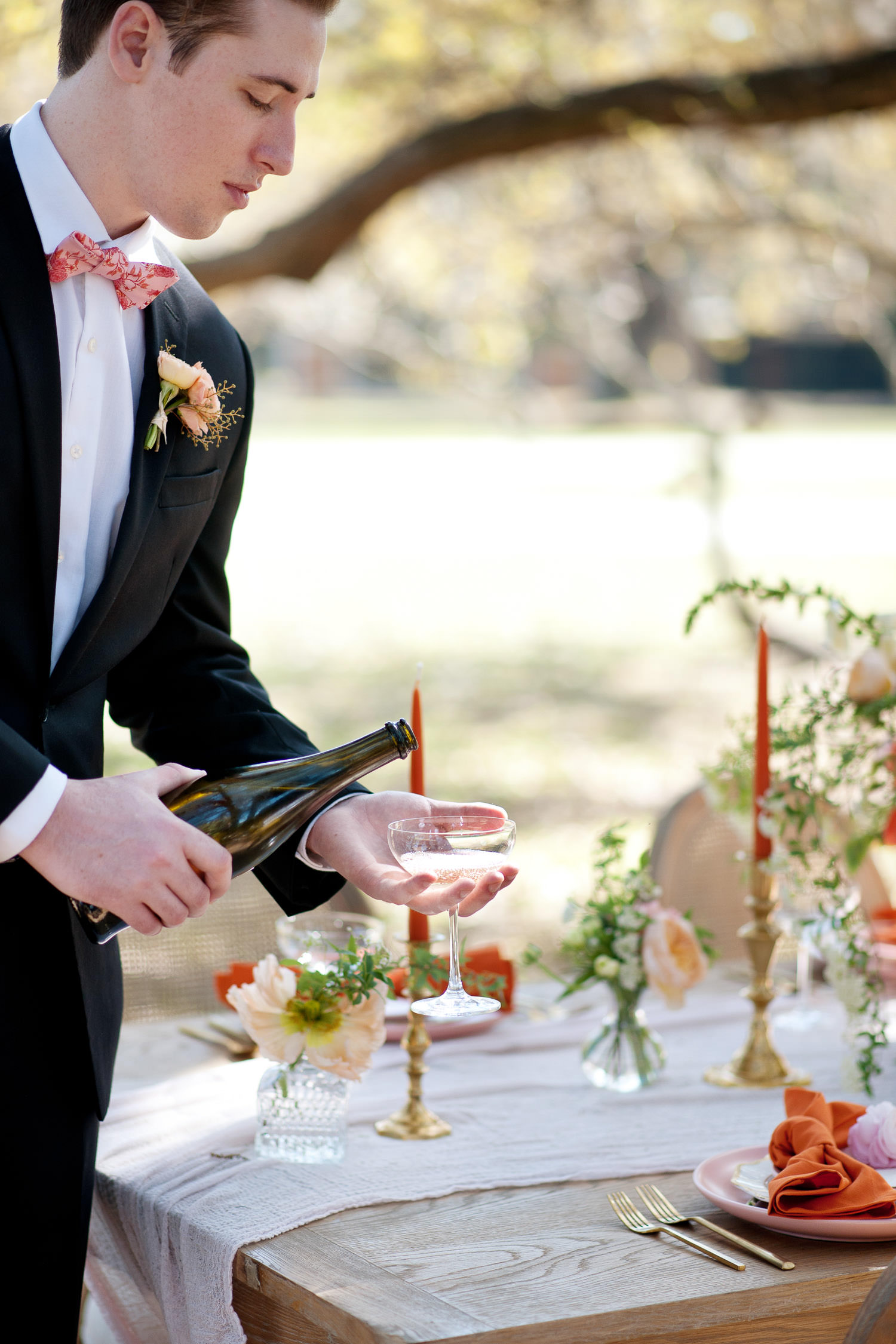 groom pours champagne for a toast captured by Tara Whittaker Photography