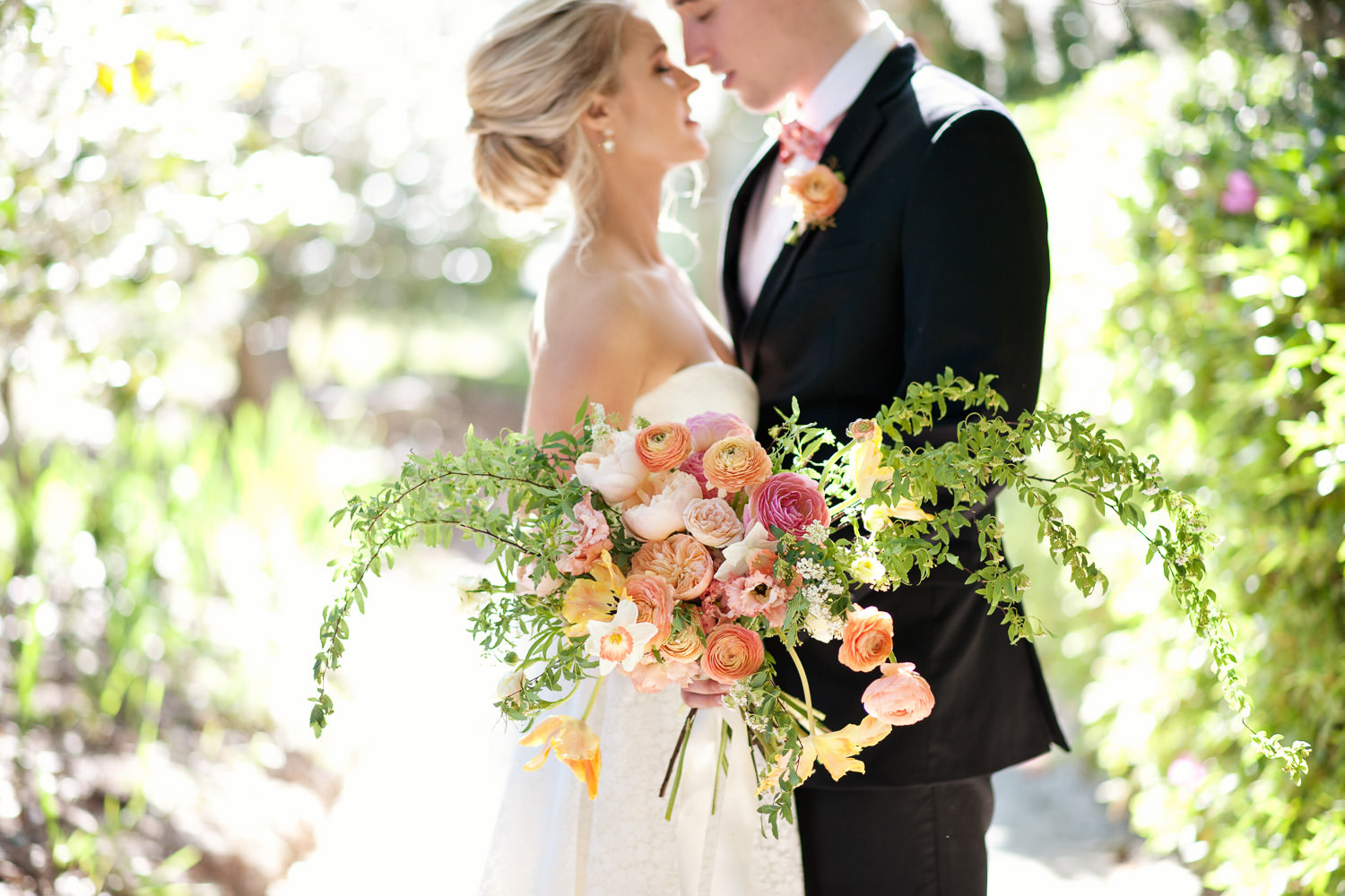 Bride and groom with her romantic bouquet captured by Tara Whittaker Photography