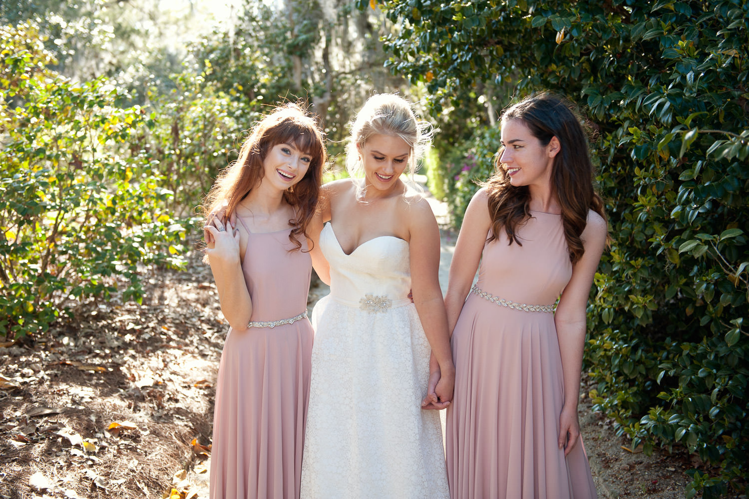 Bride with her two bridesmaids captured by Tara Whittaker Photography