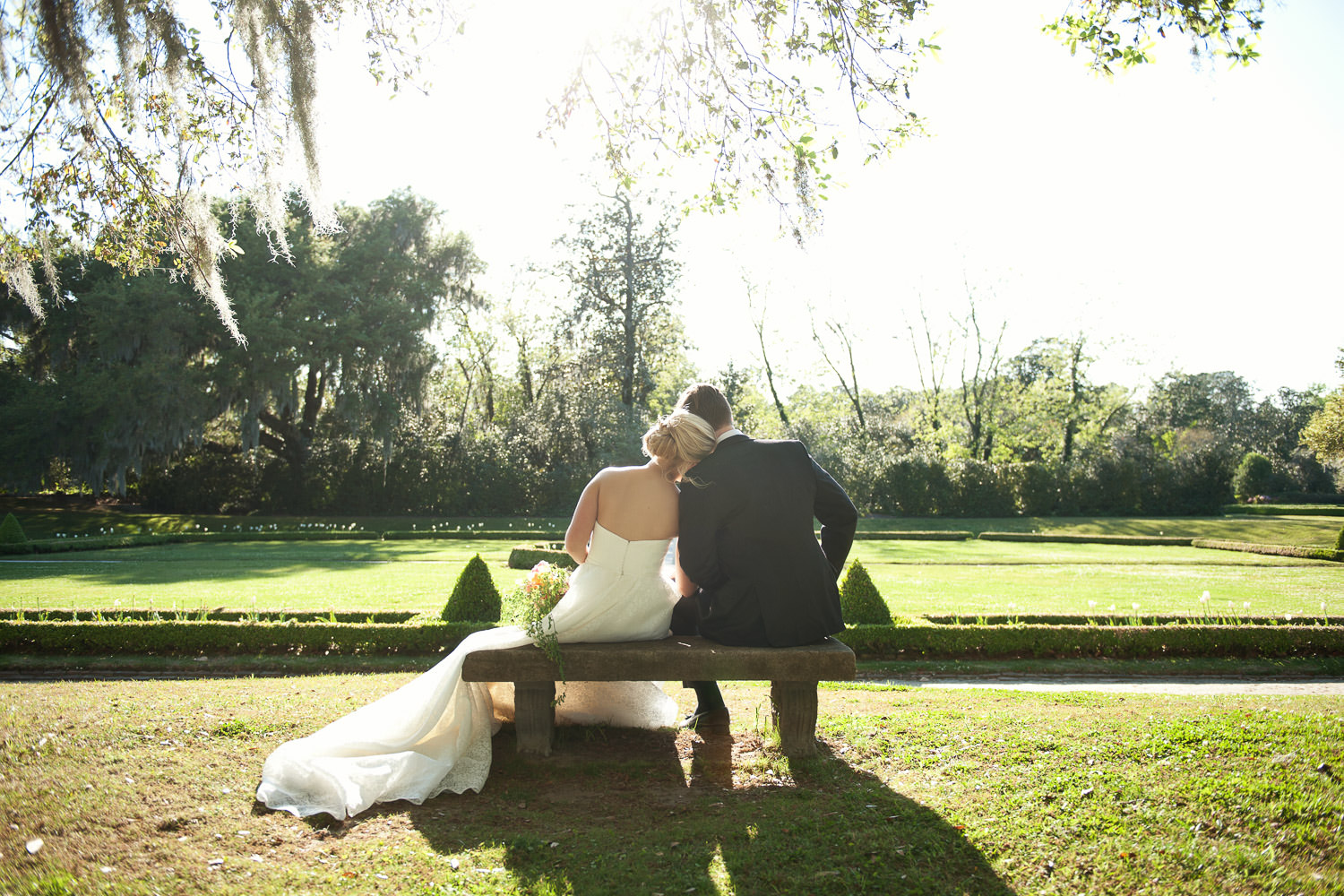 bride and groom in the gardens at Middleton Place captured by Tara Whittaker Photography
