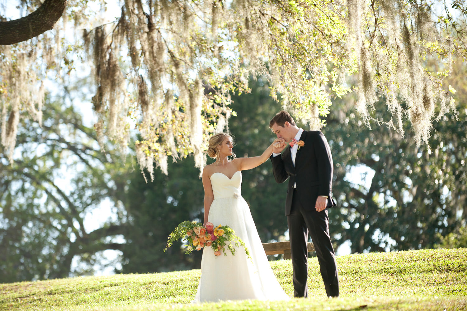 bride and groom among the spanish moss at Middleton Place captured by Tara Whittaker Photography