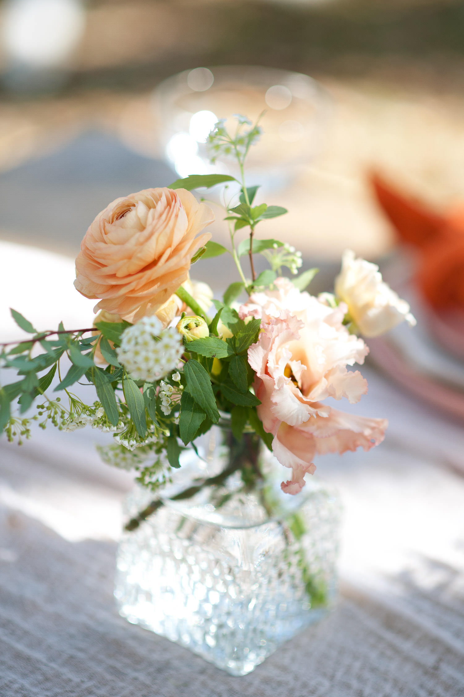 Vase of spring flowers at a garden wedding captured by Tara Whittaker Photography