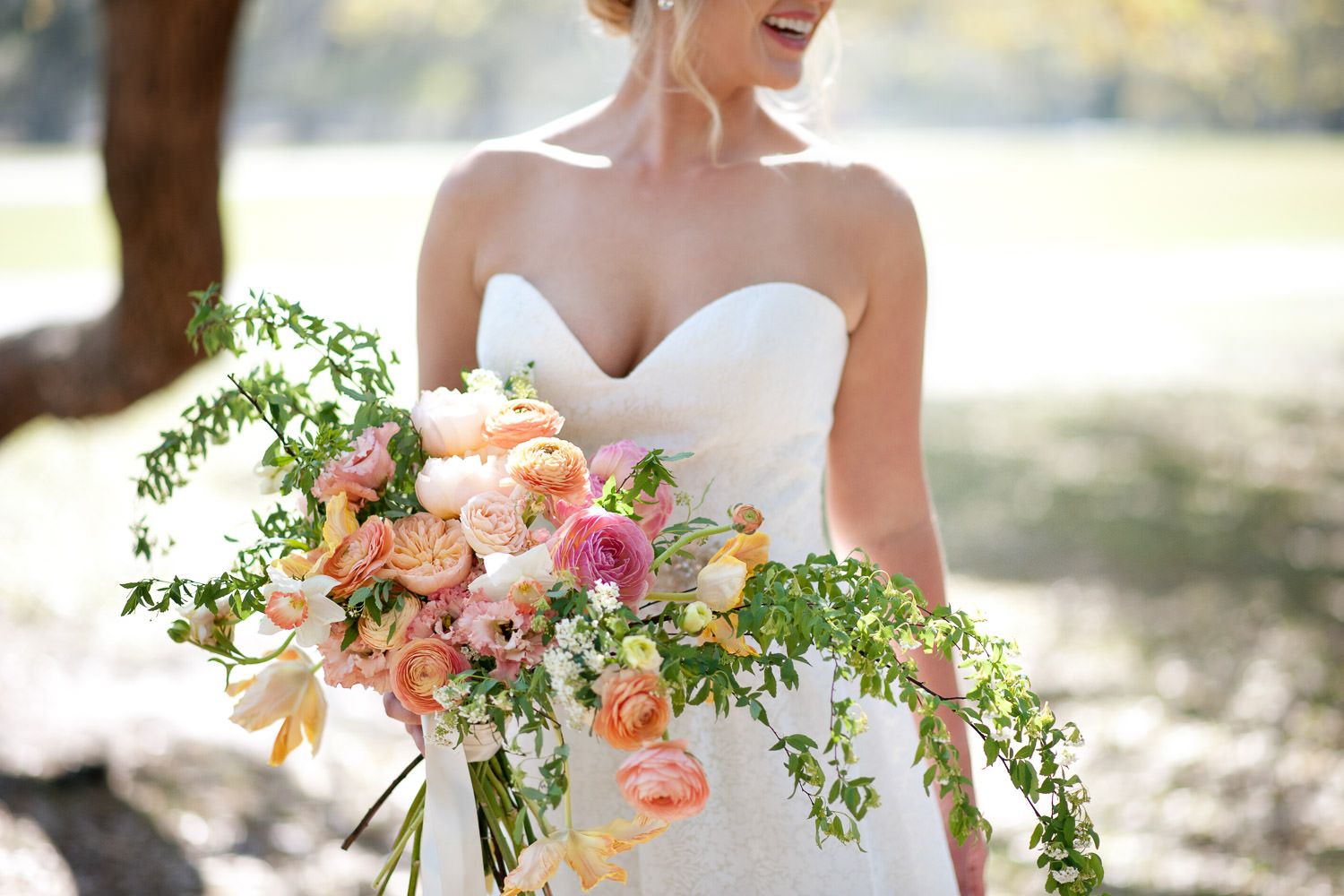bride holds her spring bouquet captured by Tara Whittaker Photography