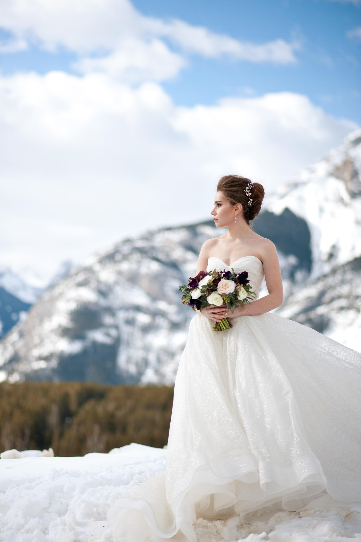 winter bride carrying her bouquet captured by Tara Whittaker Photography