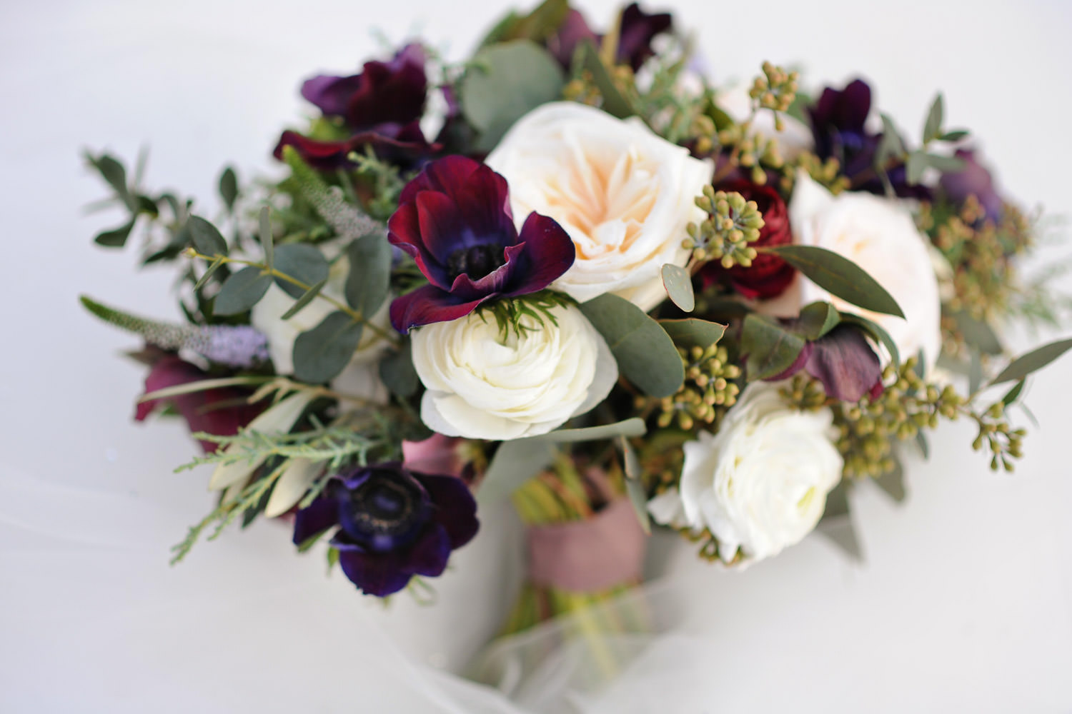 bridal bouquet of roses and anemones captured by Tara Whittaker Photography