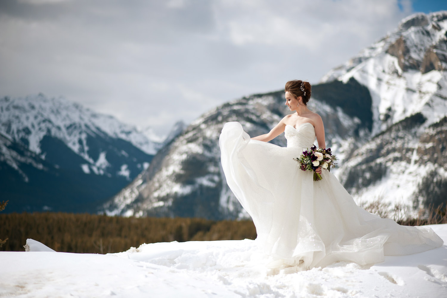 bride wears a Lazaro ballgown at Lake Minnewanka captured by Tara Whittaker Photography