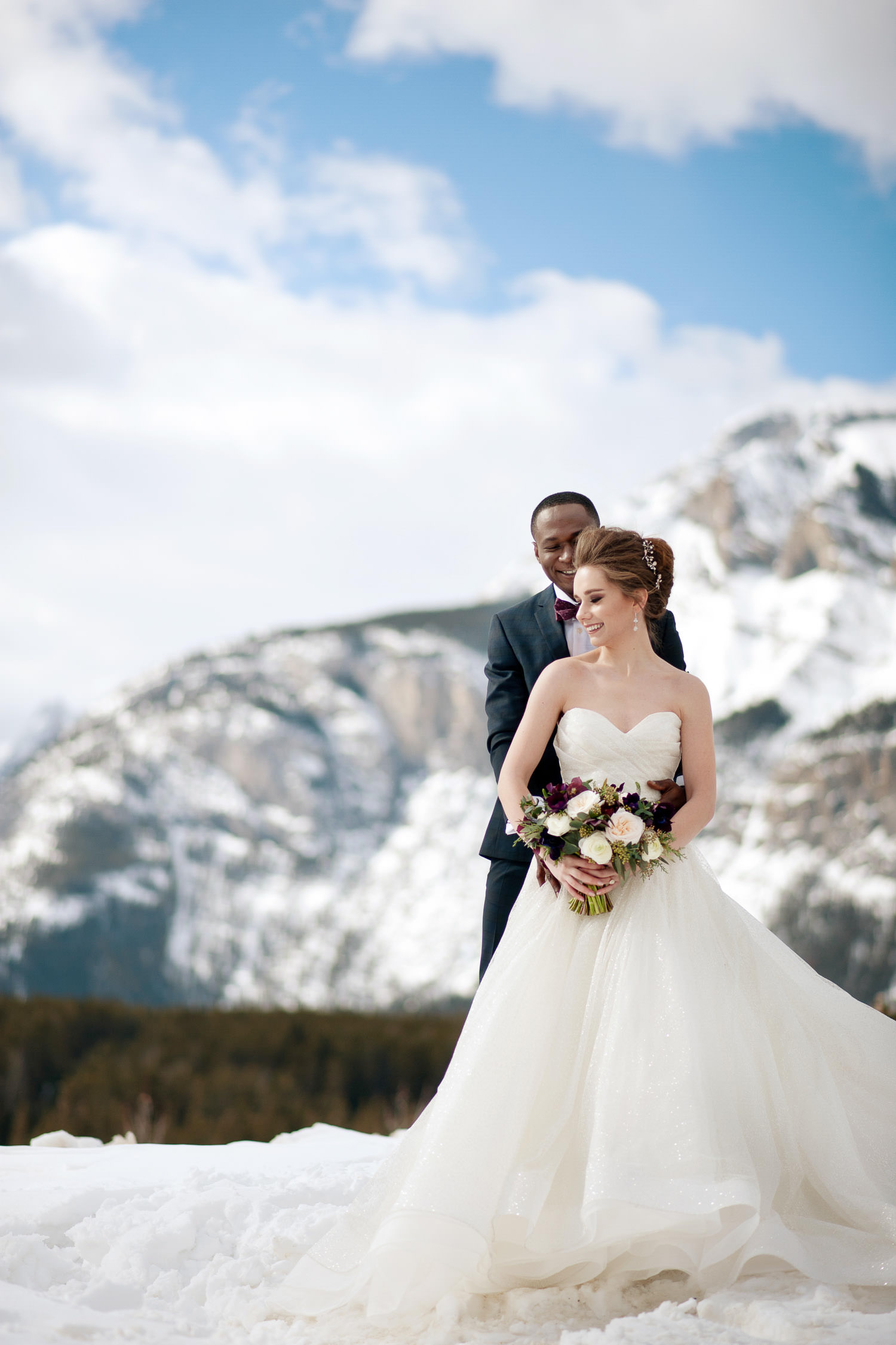 bride and groom at Lake Minnewanka captured by Tara Whittaker Photography