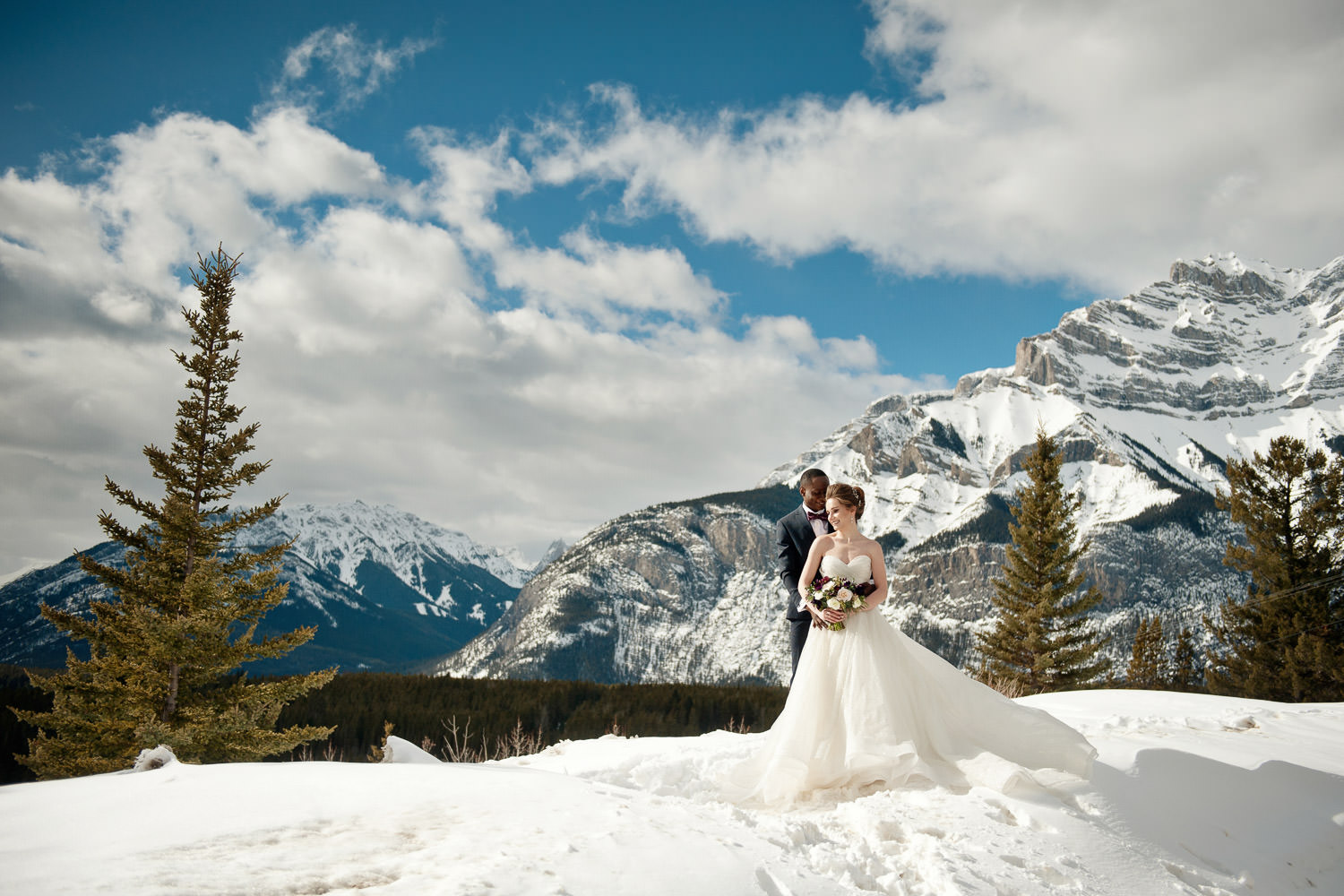 Bride and groom in the mountains near Banff captured by Tara Whittaker Photography
