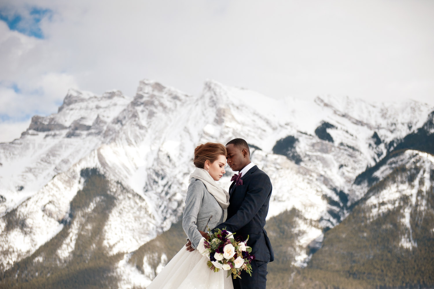 bride and groom in the mountains at Lake Minnnewanka captured by Tara Whittaker Photography