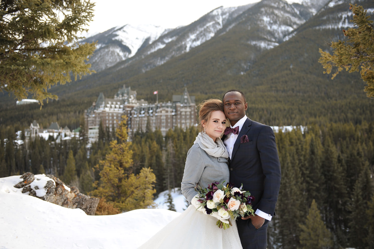 winter bride and groom in the mountains captured by Tara Whittaker Photography