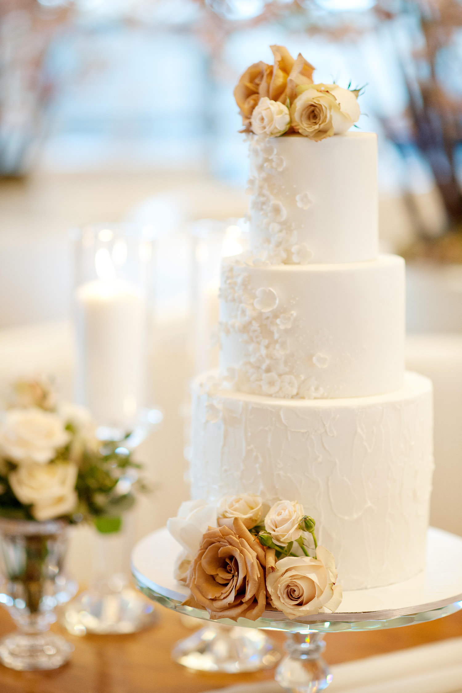 white wedding cake with delicate florals captured by Tara Whittaker Photography