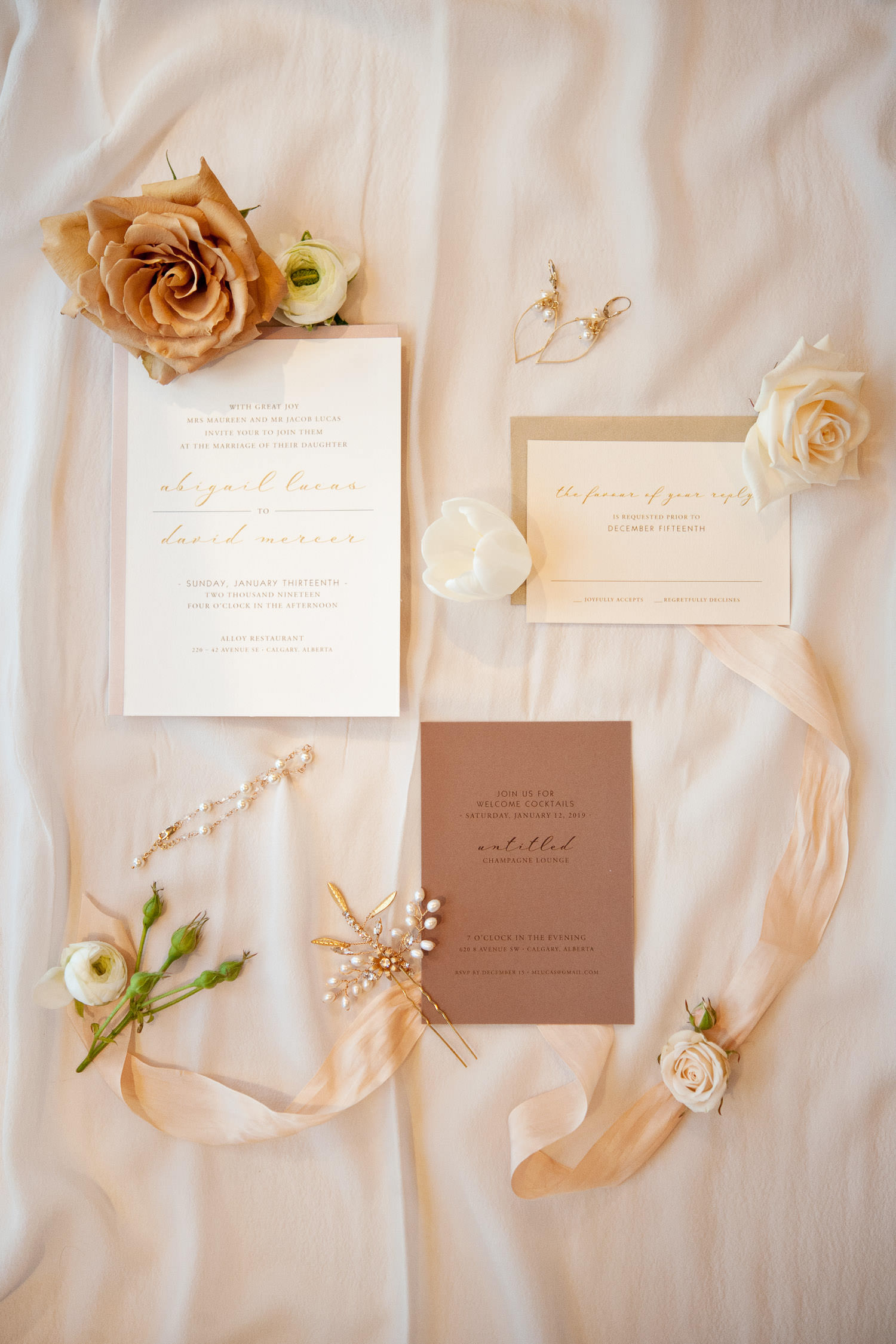 Invitation suite styled with bridal accessories captured by Tara Whittaker Photography