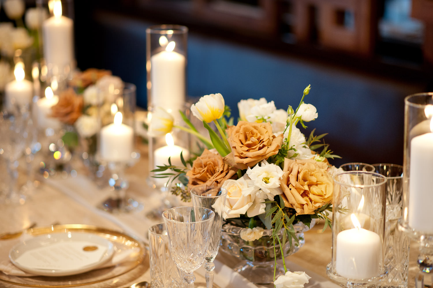 Florals in soft hues on the head table captured by Tara Whittaker Photography