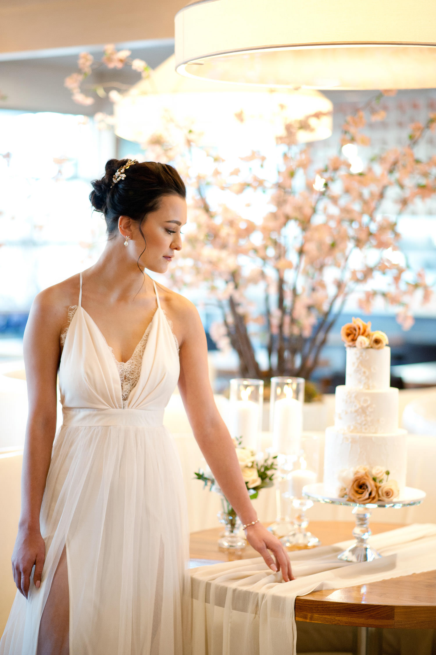 bride with her wedding cake captured by Tara Whittaker Photography