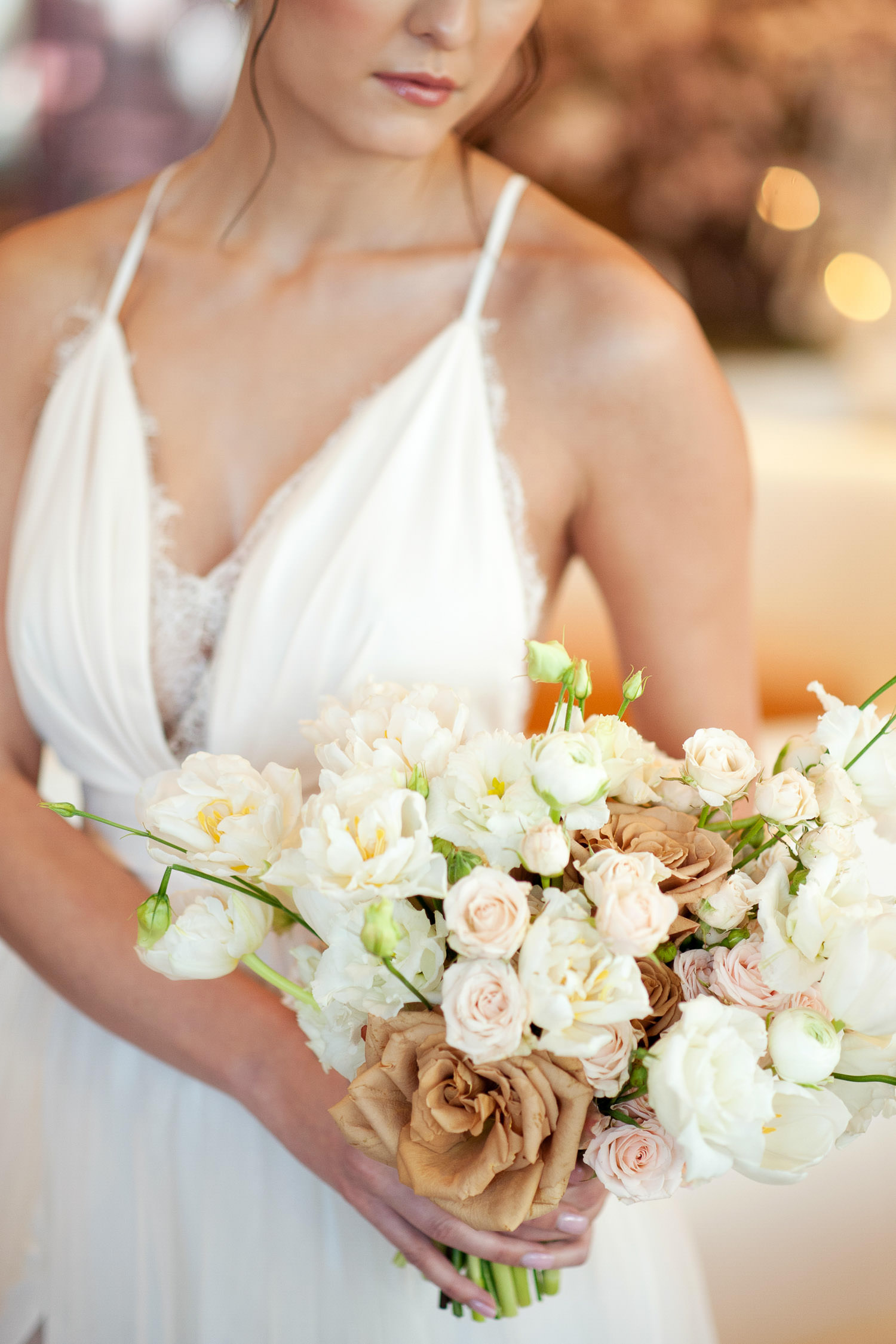 bride carries her bouquet with toffee roses captured by Tara Whittaker Photography