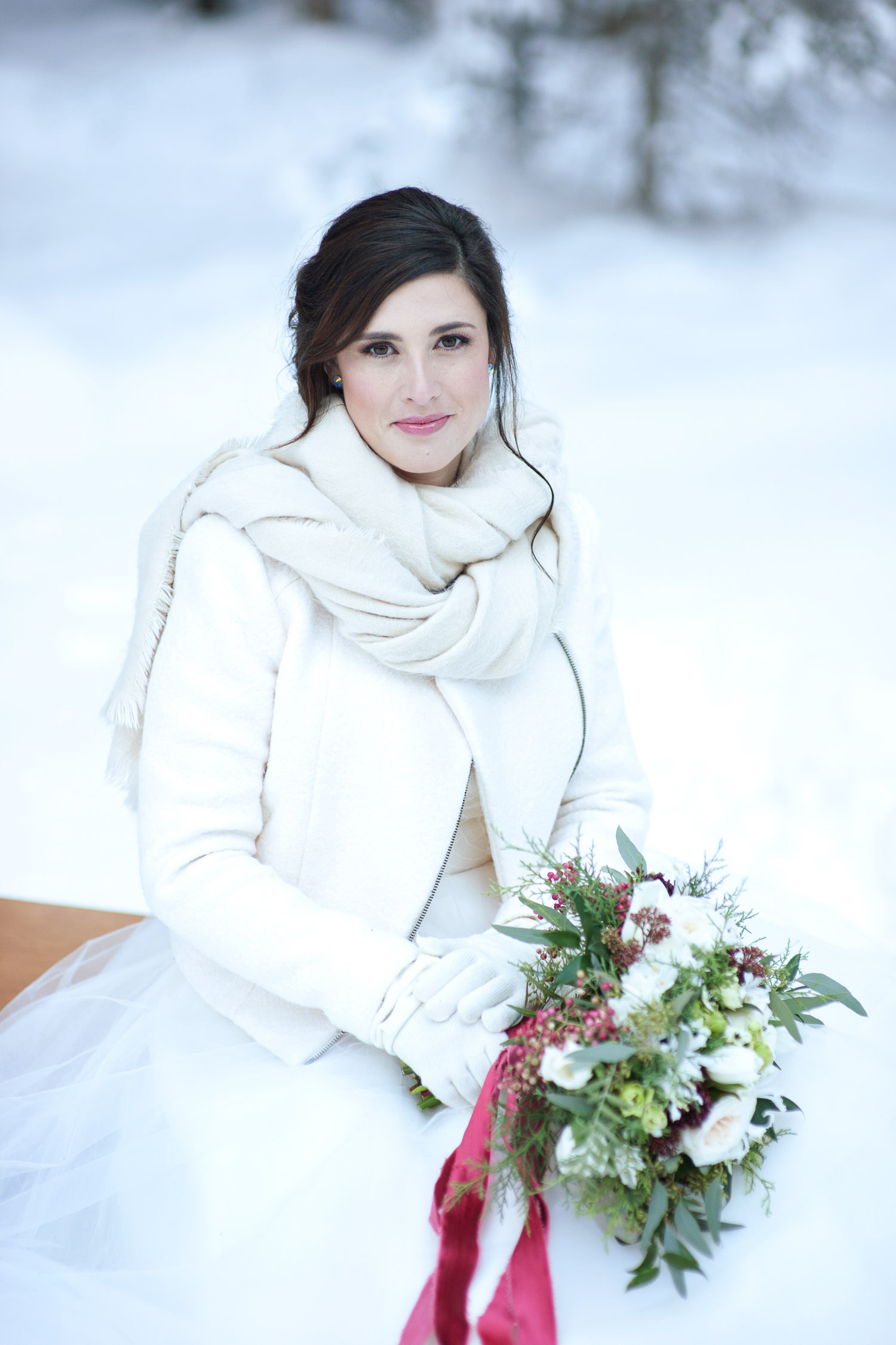 winter bride wrapped in white scarf captured by Tara Whittaker Photography