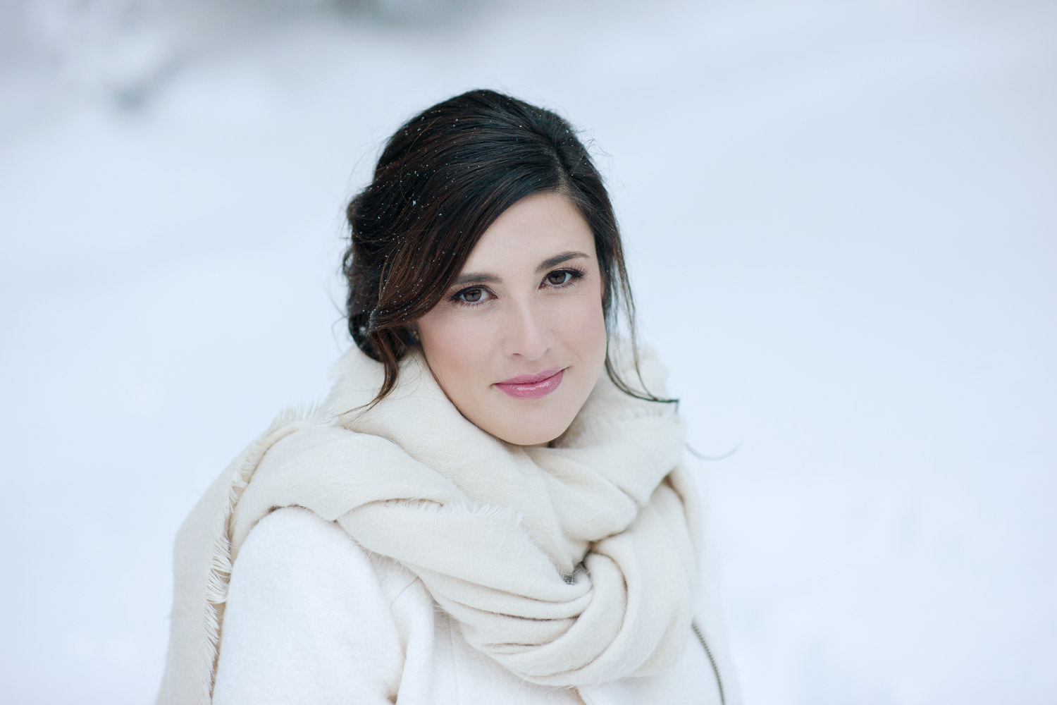 winter bride wrapped in pretty white scarp captured by Tara Whittaker Photography