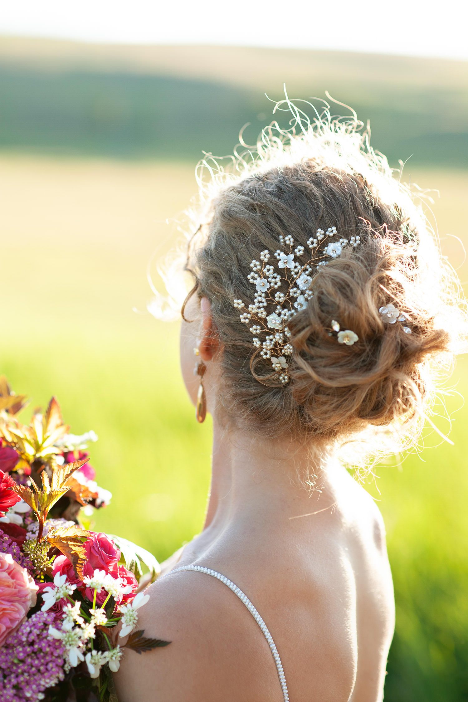 Bride wears a pearl headpiece and pins by Joanna Bisley Design captured by Tara Whittaker Photography
