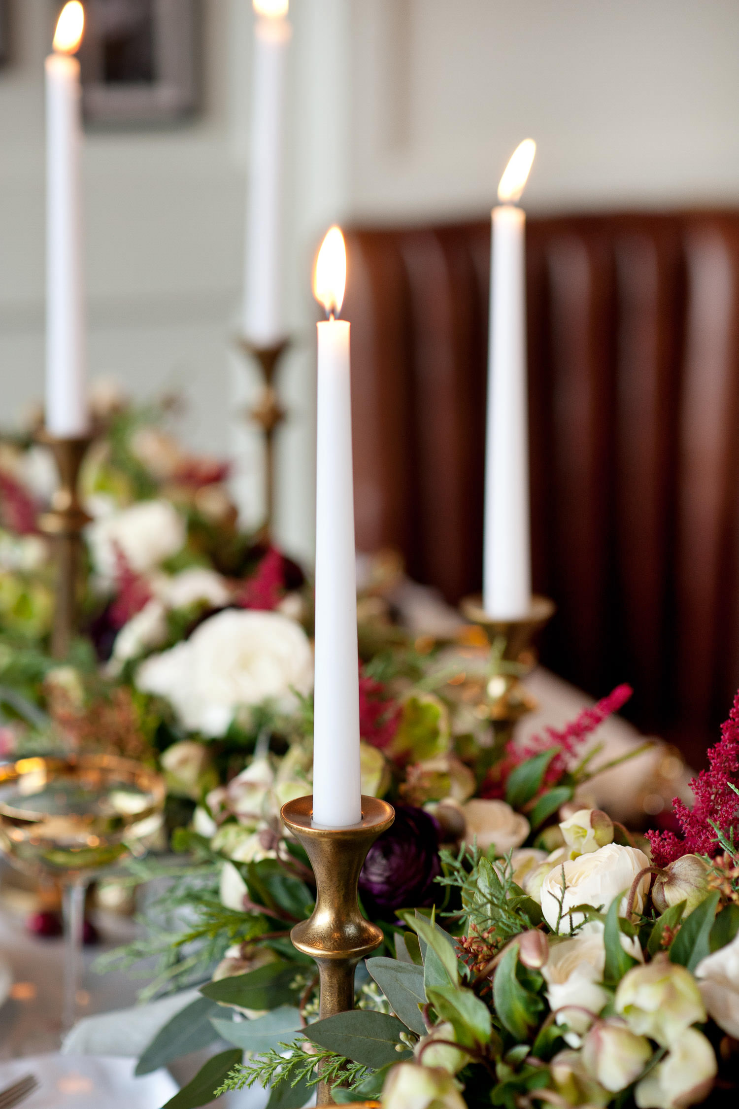winter blooms and gold candlesticks at a December wedding captured by Tara Whittaker Photography