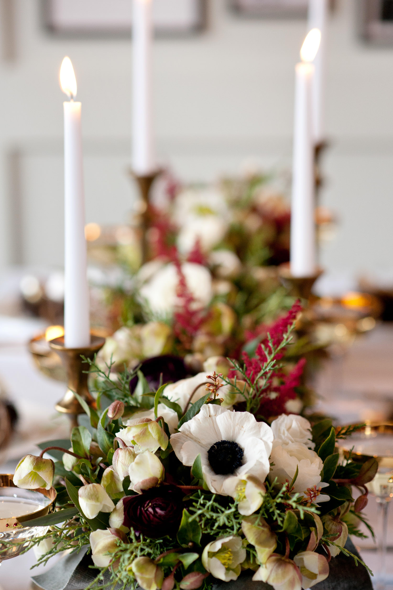 Panda anemones on a holiday table captured by Tara Whittaker Photography