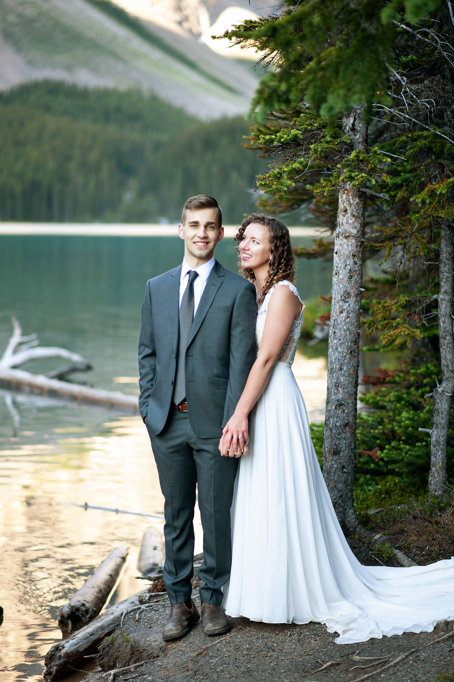 bride and groom on the shore of Moraine Lake captured by Tara Whittaker Photography