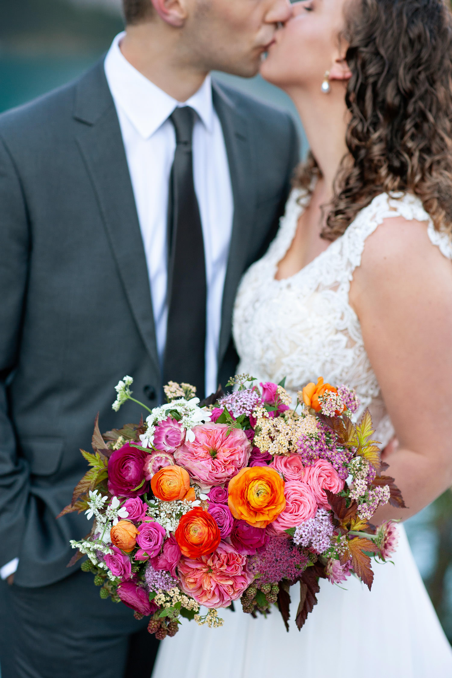 bride holds her vibrant bouquet at her Moraine Lake wedding captured by Tara Whittaker Photography