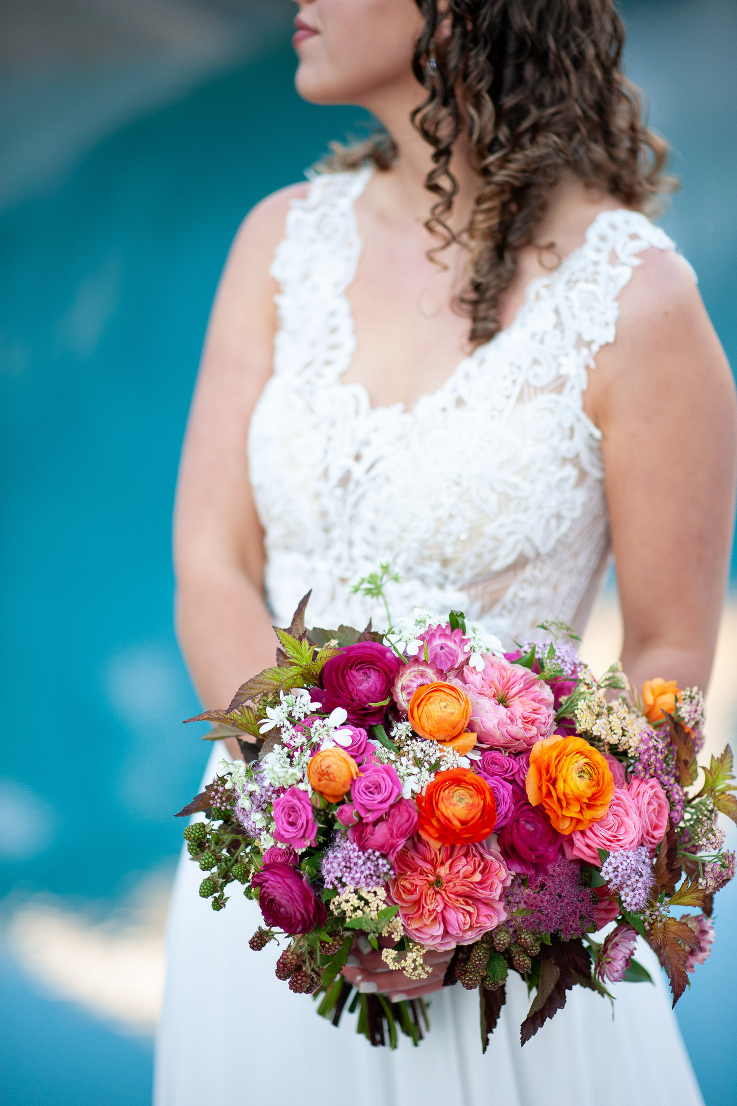 bride with her colorful bouquet from Flowers by Janie captured by Tara Whittaker Photography