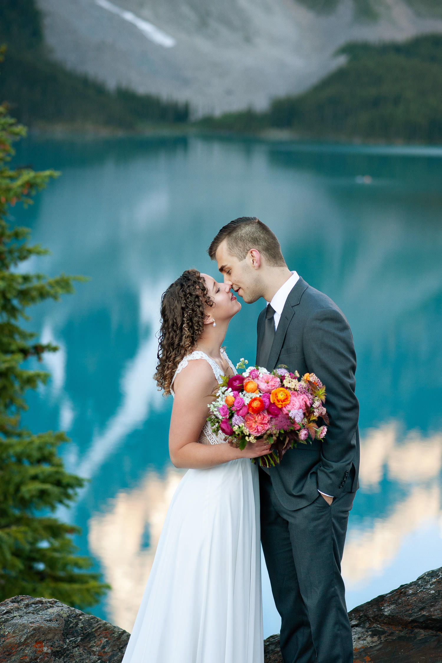 bride and groom above Moraine Lake at sunrise captured by Tara Whittaker Photography