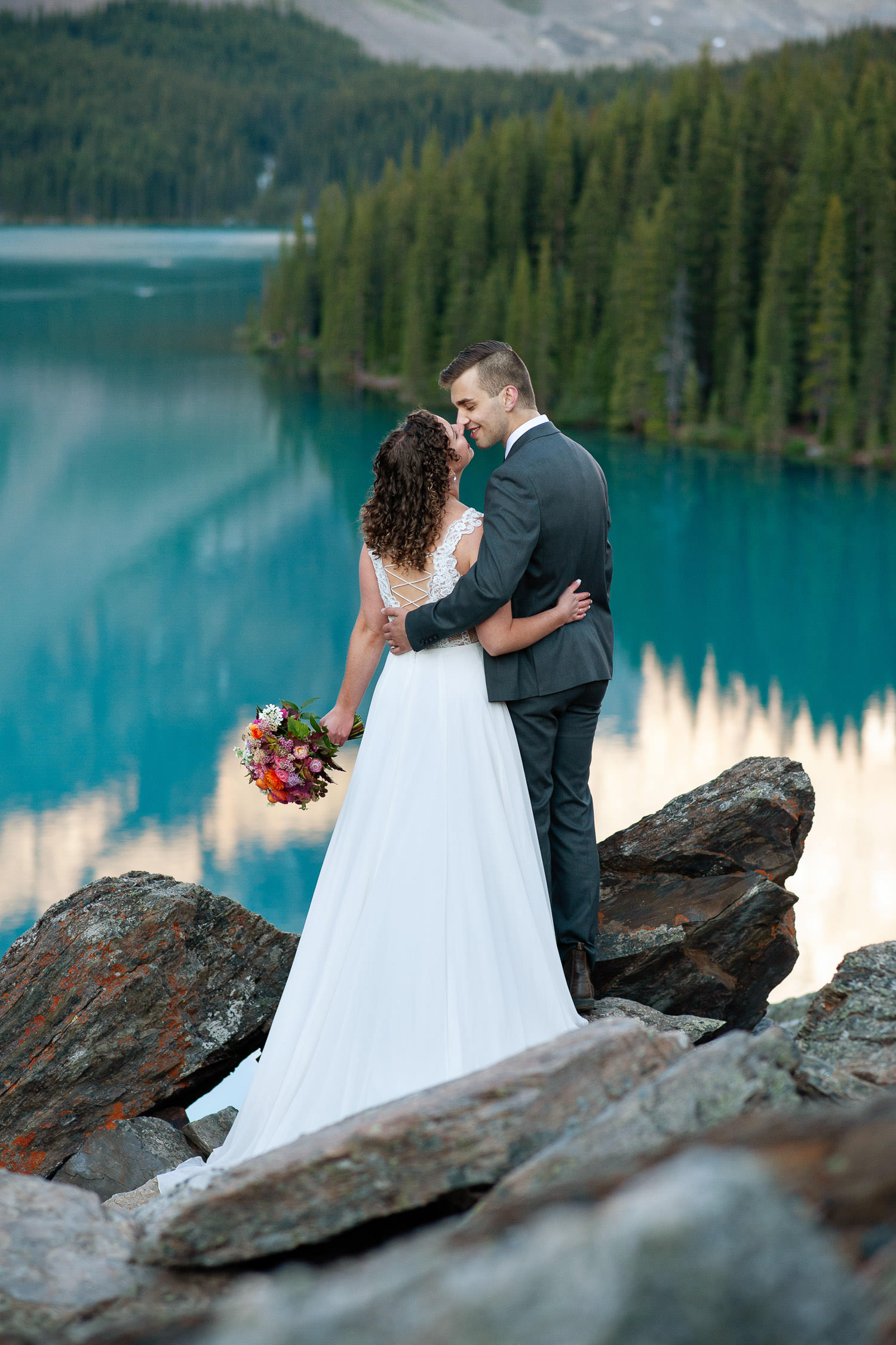 bride and groom during their Moraine Lake wedding photos captured by Tara Whittaker Photography